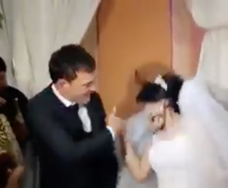 A newlywed man slaps his bride across the face (Source: Facebook)