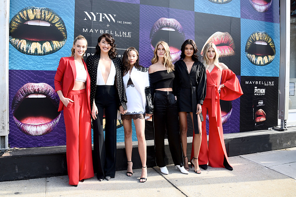Stars of E!'s Model Squad Hannah Ferguson, Ping Hue, Ashley Moore, Caroline Lowe, Daniella Brag and Devon Windsor pose in front of the Maybelline installation at IMG NYFW: The Shows on February 8, 2018 in New York City. (Photo by Bryan Bedder/Getty Images for IMG)