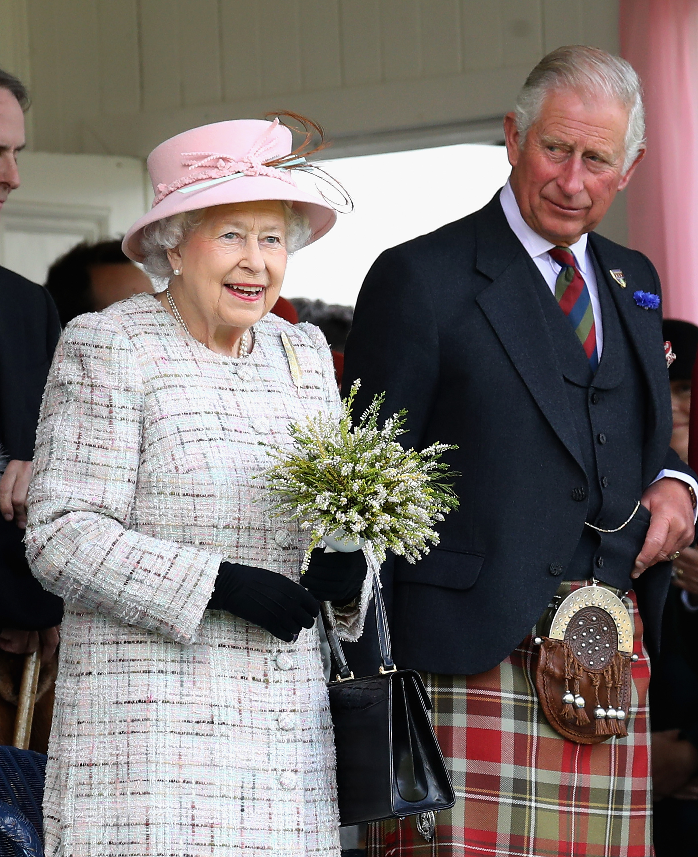 Queen Elizabeth II and Prince Charles, Prince of Wales watch the 2017 Braemar Gathering at The Princess Royal and Duke of Fife Memorial Park on September 2, 2017 in Braemar, Scotland.