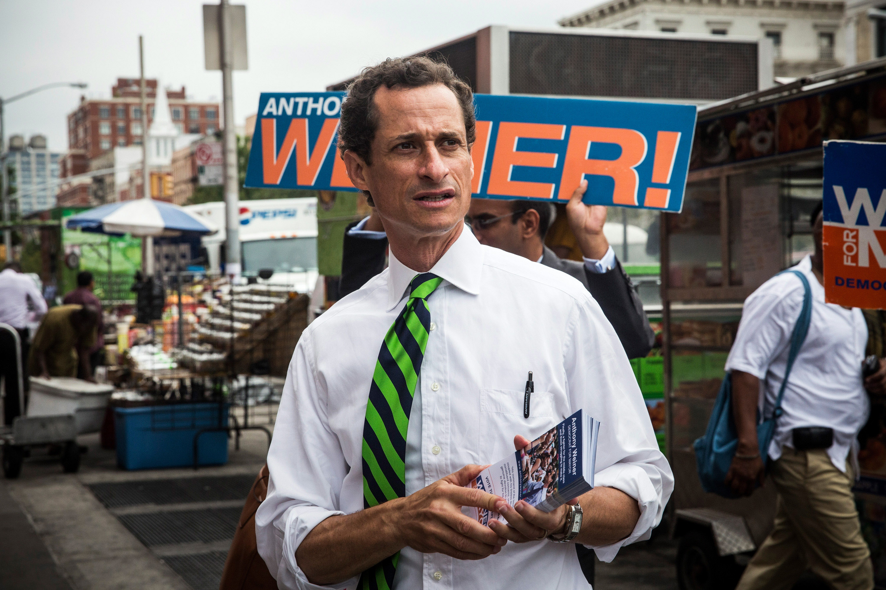 New York City mayoral hopeful Anthony Weiner meets with people on a street corner In Harlem on September 10, 2013 in New York City. Registered voters in New York are voting today in the Democratic and Republican primary races to nominate party candidates for the New York mayoral race. (Getty Images)