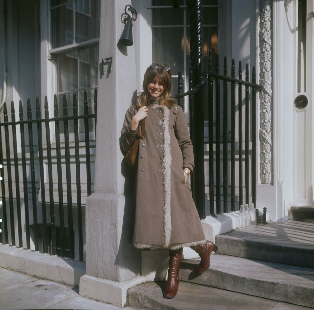 English-Australian singer, Olivia Newton-John, wearing a three-quarter length coat and boots, London, circa 1970. (Photo by Keystone/Hulton Archive/Getty Images)