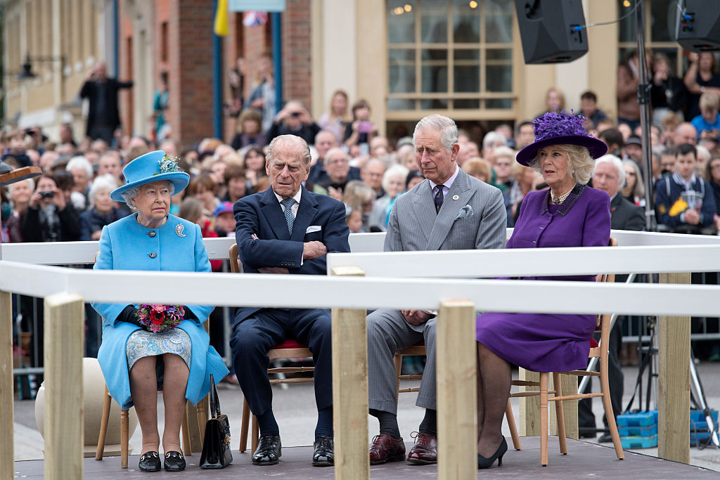 Britain's Queen Elizabeth II, Prince Philip, Duke of Edinburgh, Britain's Prince Charles, Prince of Wales, and Camilla, Duchess of Cornwall listen to speeches before a statue of the Queen Elizabeth, The Queen Mother was unveiled on October 27, 2016 in Poundbury, England (Photo by Justin Tallis - WPA Pool/Getty Images)
