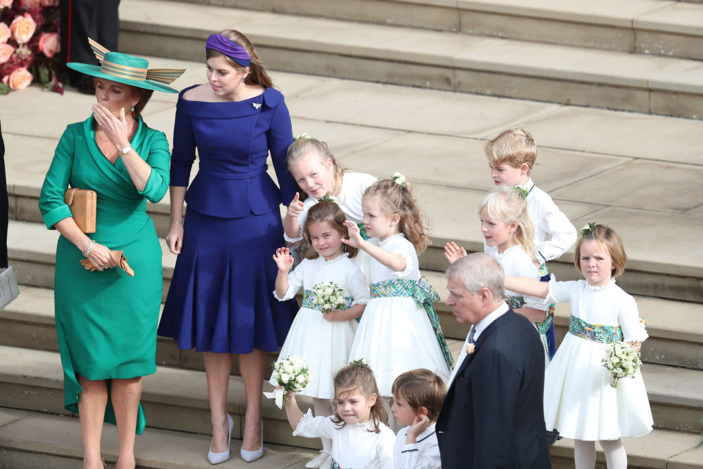 Sarah, Duchess of York and Princess Beatrice of York and the bridesmaids and pageboys, including Princess Charlotte and Prince George, wave off Princess Eugenie of York and Mr. Jack Brooksbank following their wedding at St. George's Chapel on October 12, 2018, in Windsor, England. (Getty Images)