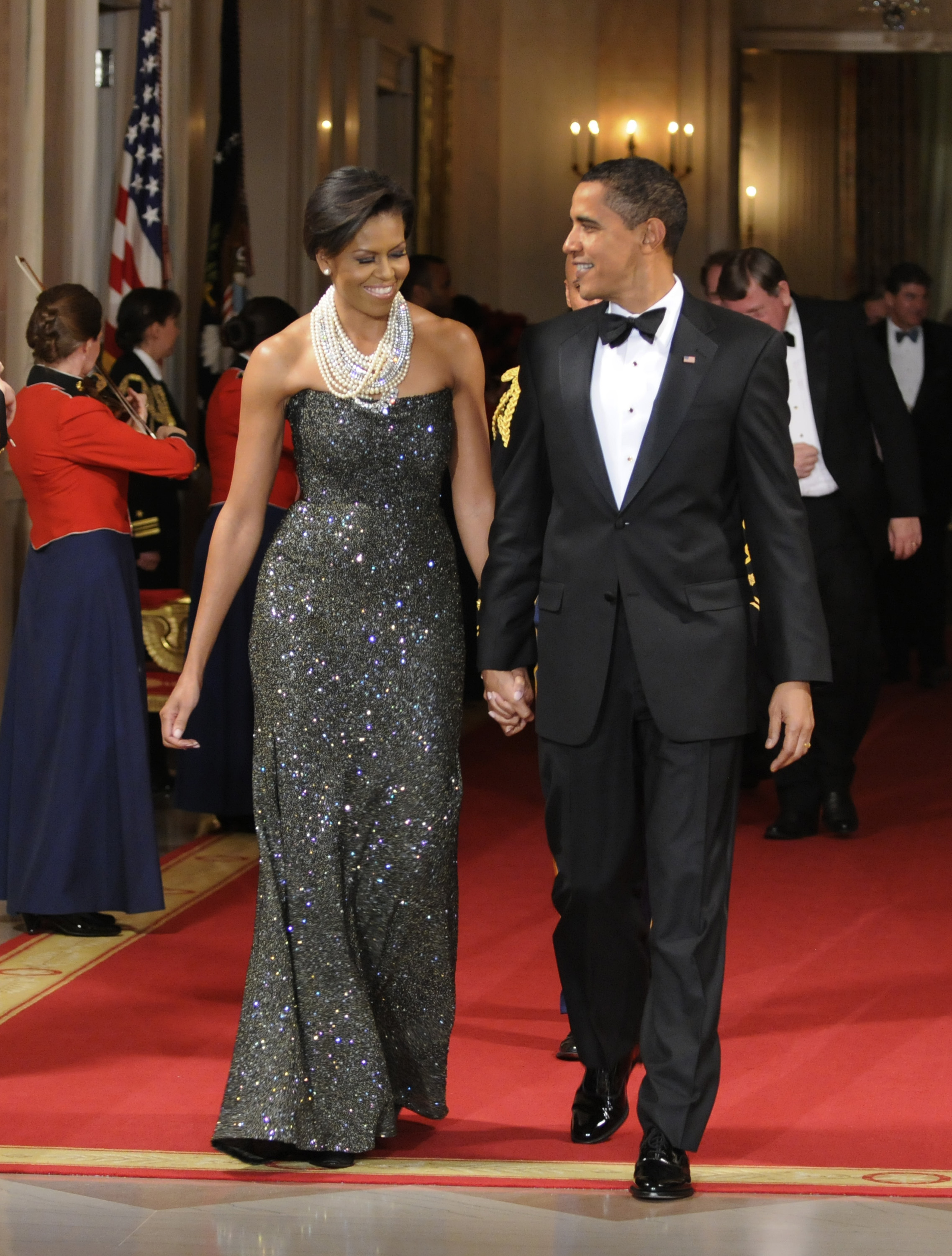 Former president Barack Obama and former first Lady Michelle Obama enter the East Room for entertainment after a black-tie dinner at the White House on February 22, 2009 in Washington, DC. (Photo by Mike Theiler-Pool/Getty Images)