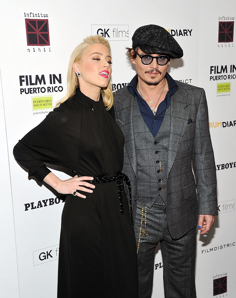 Actors Amber Heard (L) and Johnny Depp attend the 'The Rum Diary' New York premiere at the Museum of Modern Art on October 25, 2011, in New York City. (Photo by Mike Coppola/Getty Images)