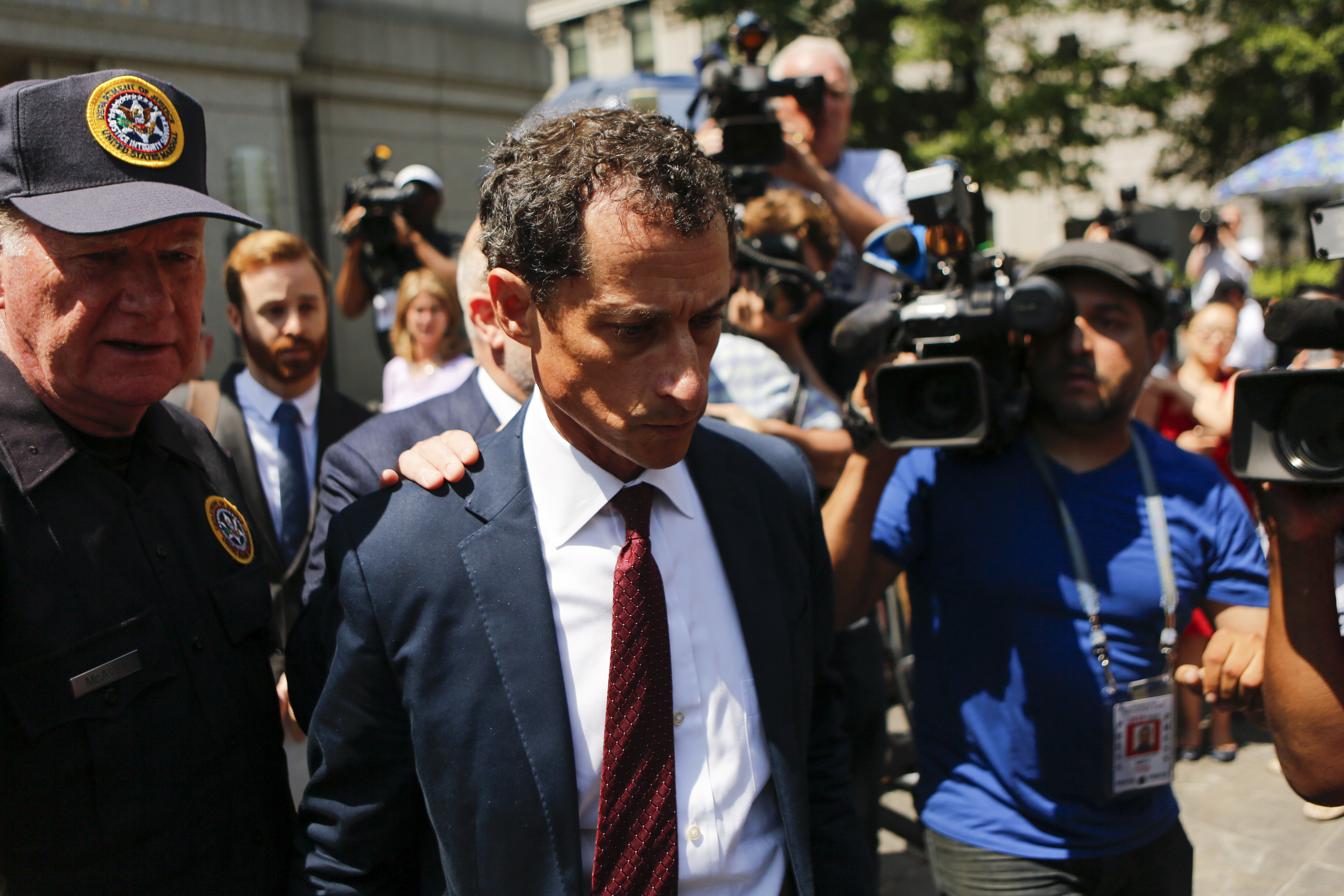 Former Democratic Congressman Anthony Weiner (C) exits federal court in Manhattan after pleading guilty in sexting case on May 19, 2017 in New York City. Weiner, who resigned from Congress over a sexting scanal, pleaded guilty on friday to federal charges of transmitting sexual material to a minor and could face a prison term. (Getty Images)