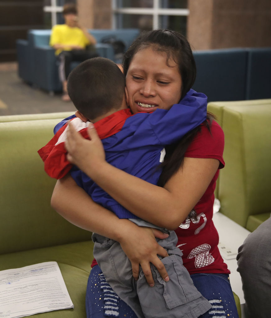 A woman, identified only as Maria, is reunited with her son Franco, 4, at the El Paso International Airport on July 26, 2018, in El Paso, Texas (Source: Joe Raedle/Getty Images)