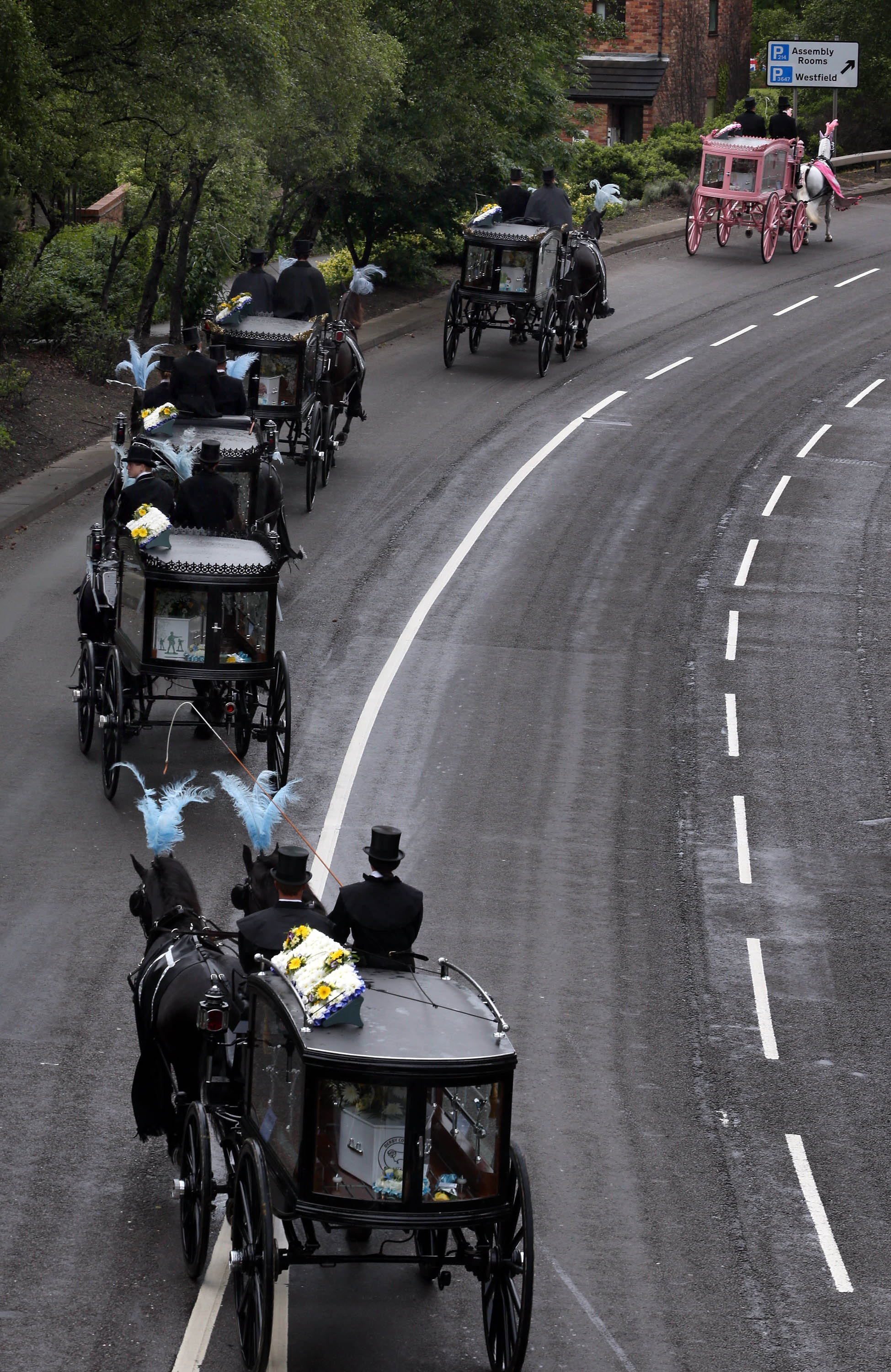 Horse-drawn hearses travel to St Mary's Church carrying the coffins of the six Philpott children on June 22, 2012, in Derby, England (Source: Peter Macdiarmid/Getty Images)