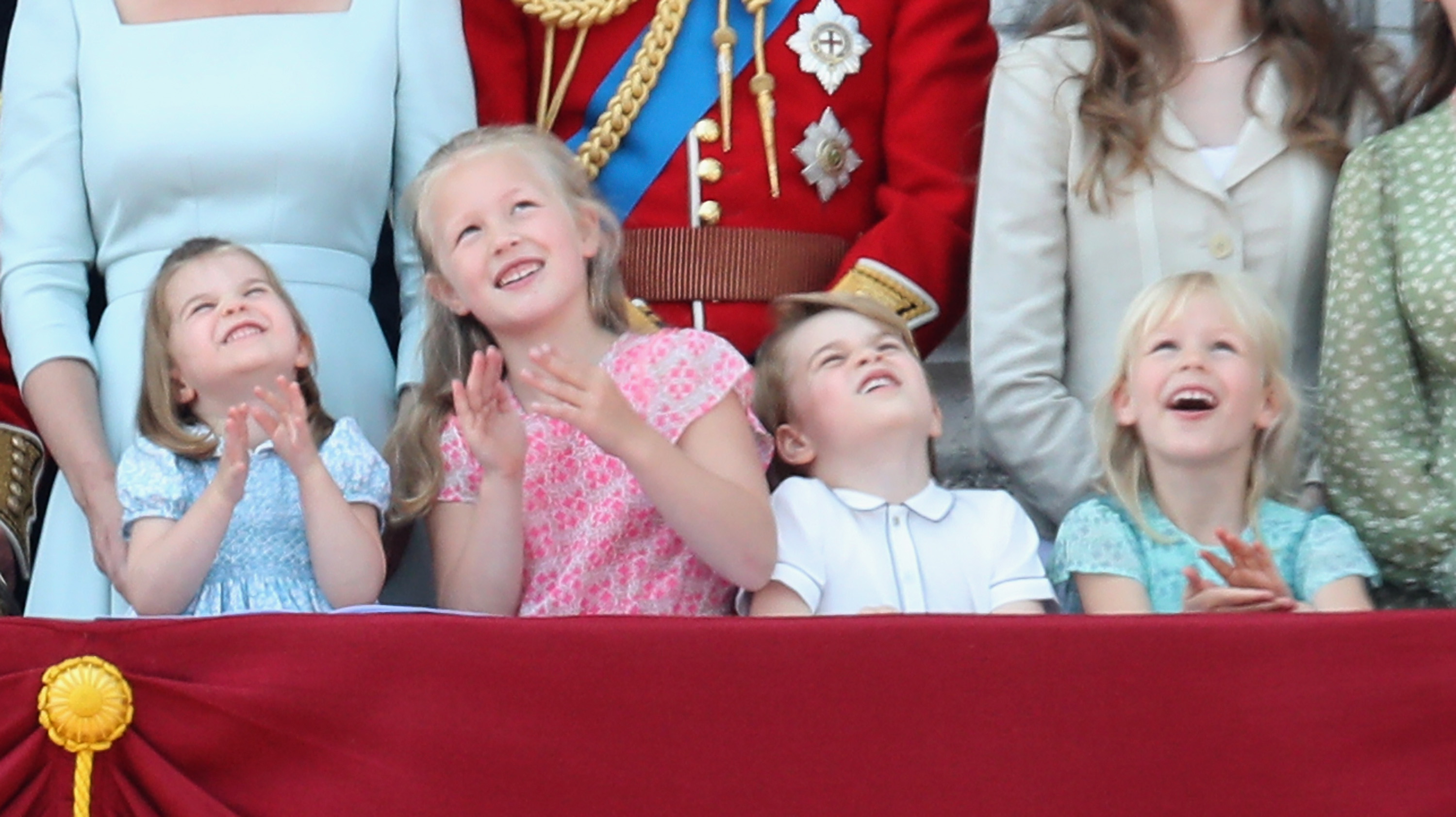 Princess Charlotte of Cambridge, Savannah Phillips, Prince George of Cambridge and Isla Phillips watch the flypast on the balcony of Buckingham Palace during Trooping The Colour on June 9, 2018, in London, England. (Getty Images)