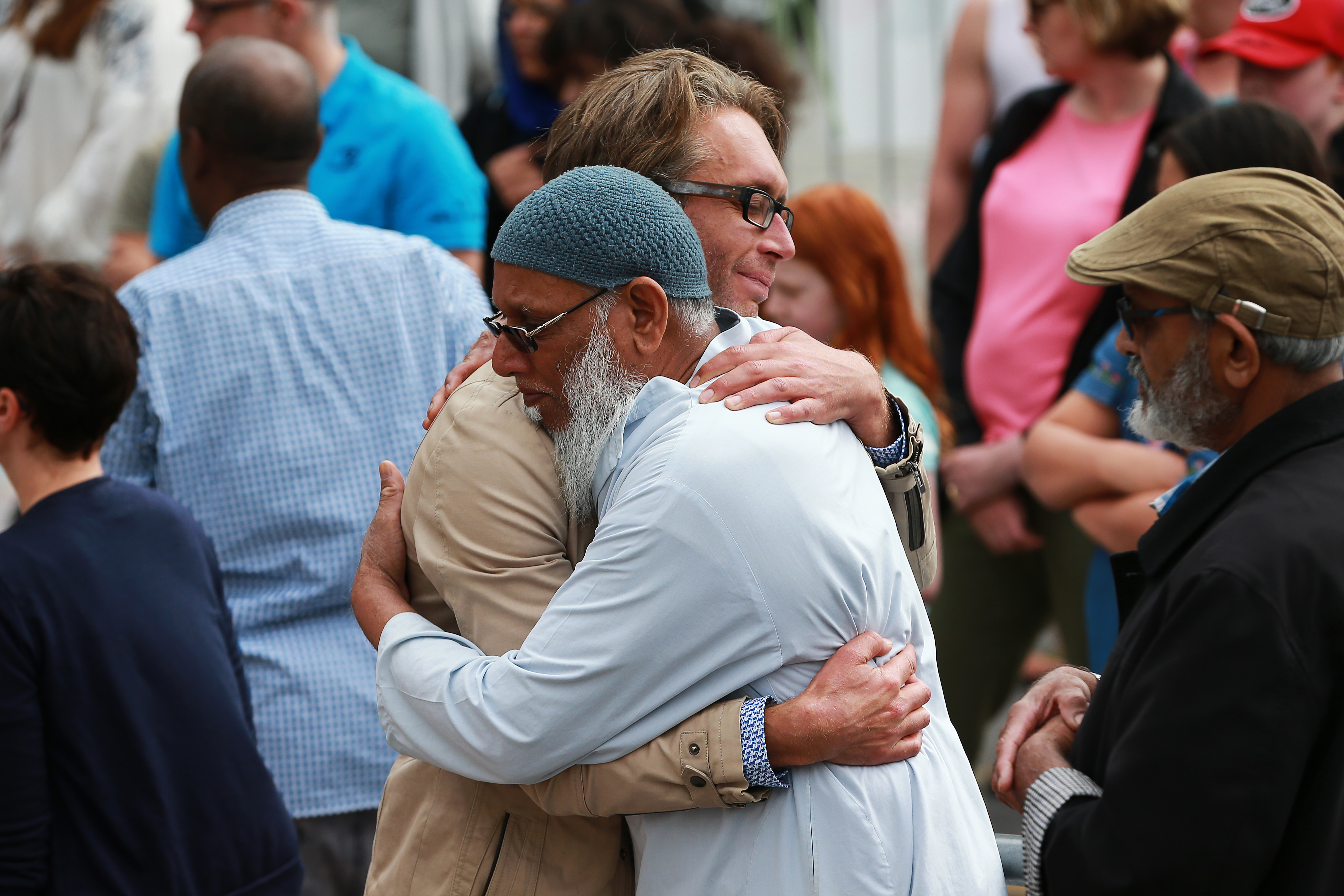 A member of the public and a mosque-goer embrace at the Kilbirnie Mosque on March 17, 2019, in Wellington, New Zealand. (Getty)