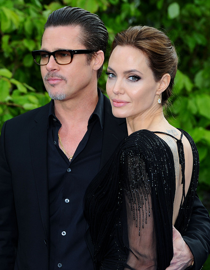 Brad Pitt and Angelina Jolie attend a private reception as costumes and props from Disney's 'Maleficent' are exhibited in support of Great Ormond Street Hospital at Kensington Palace on May 8, 2014 in London, England. (Photo by Anthony Harvey/Getty Images)