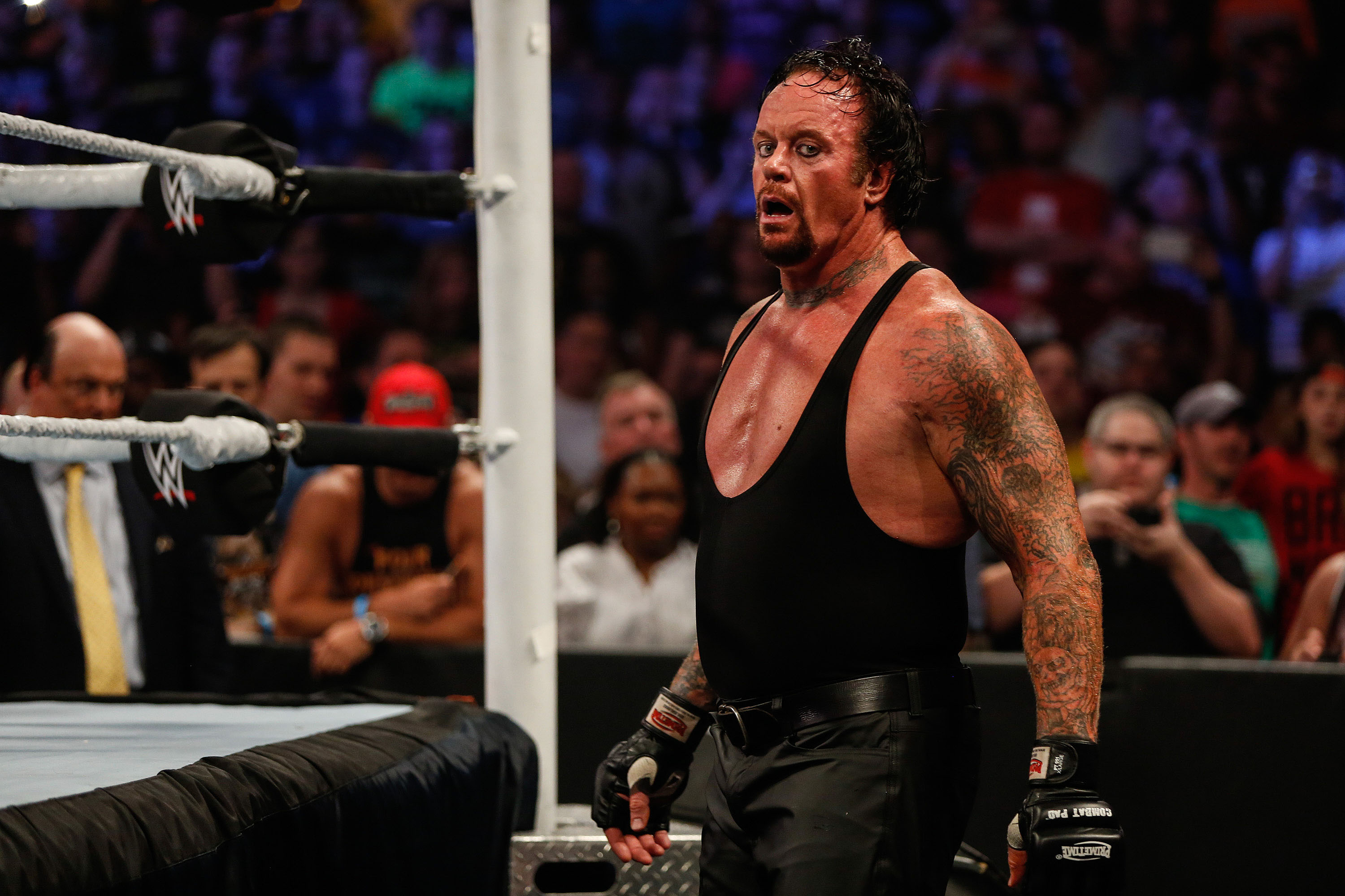 The Undertaker recovers during his fight against Brock Lesner at the WWE SummerSlam 2015 at Barclays Center of Brooklyn in New York City. (Photo by JP Yim/Getty Images)