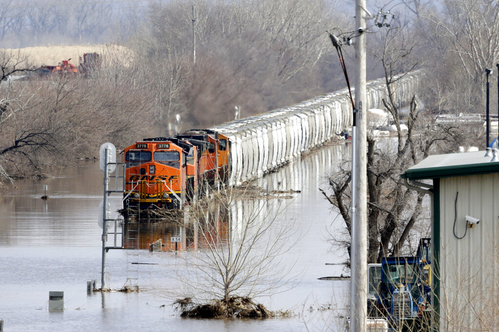 A BNSF train sits in flood waters from the Platte River, in Plattsmouth, Neb., Sunday, March 17, 2019 (AP Photo/Nati Harnik)