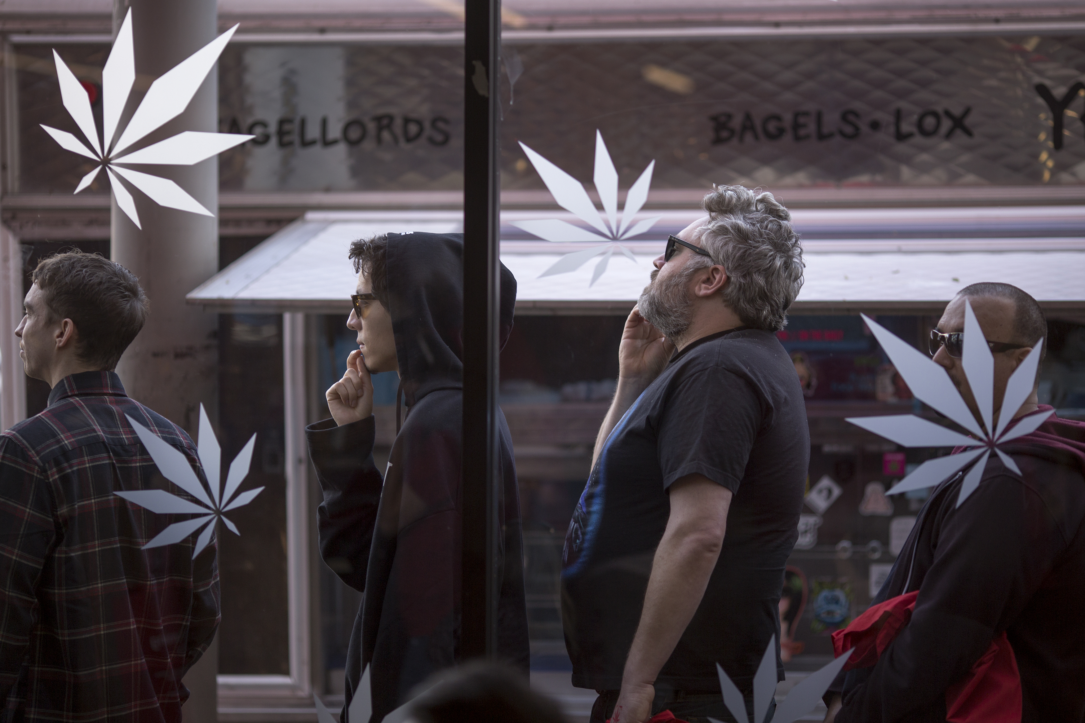 People stand in line to get into MedMen, one of the two Los Angeles area pot shops that began selling marijuana for recreational use under the new California marijuana law today, on January 2, 2018 in West Hollywood, California. Los Angeles and other nearby cities outside of West Hollywood have not finalized their local permitting rules so licenses to businesses in those jurisdictions are yet to be granted. (Getty Images)