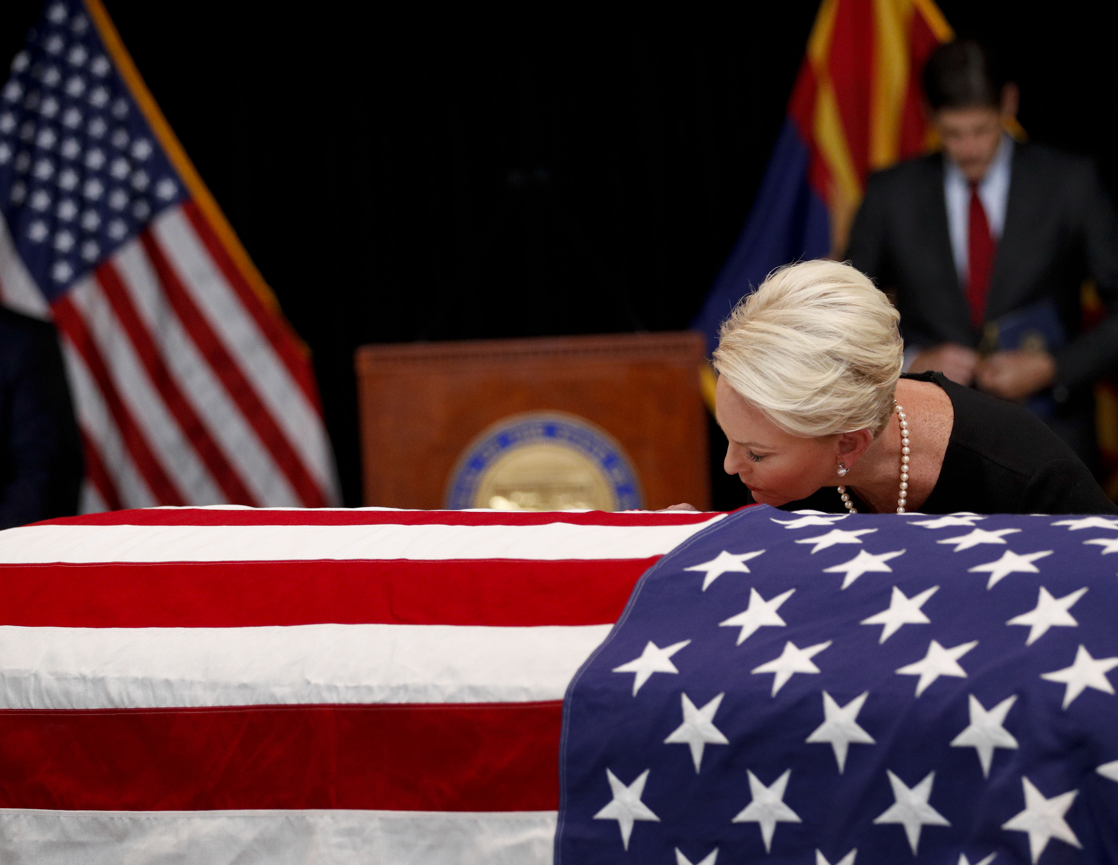Cindy McCain, wife of Sen. John McCain, R-Ariz. touches the casket during a memorial service at the Arizona Capitol on August 29, 2018 in Phoenix, Arizona. Sen. McCain, a decorated war hero, died August 25 at the age of 81 after a long battle with Glioblastoma, a form of brain cancer.