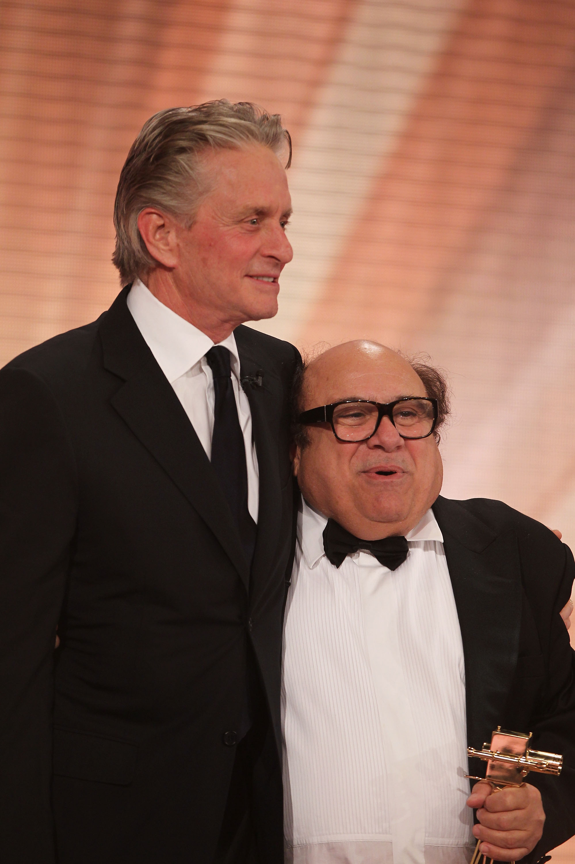 Michael Douglas hands over the award to Danny Devito for 'Lifetimeachievement International' during the Goldene Kamera 2010 Award at the Axel Springer Verlag on January 30, 2010 in Berlin, Germany. (Photo by Andreas Rentz/Getty Images)