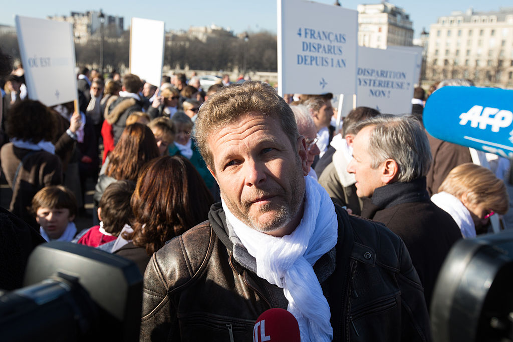 Ghyslain Wattrelos during a silent march towards the Elysee Palace in Paris to deliver a petition signed by 18000 people, on the first anniversary of the disappearance of Malaysia Airlines flight MH370 (Source: Pacific Press/LightRocket via Getty Images)