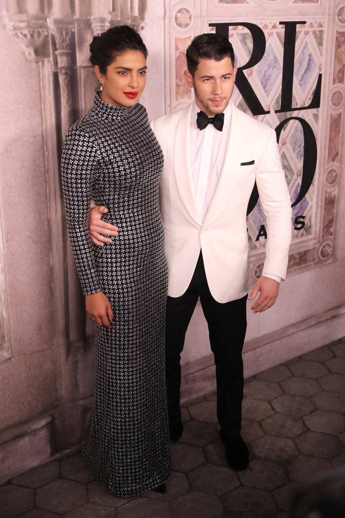 Priyanka Chopra and Nick Jonas attend the Ralph Lauren fashion show during New York Fashion Week at Bethesda Terrace on September 7, 2018 in New York City. (Photo by Rob Kim/Getty Images)