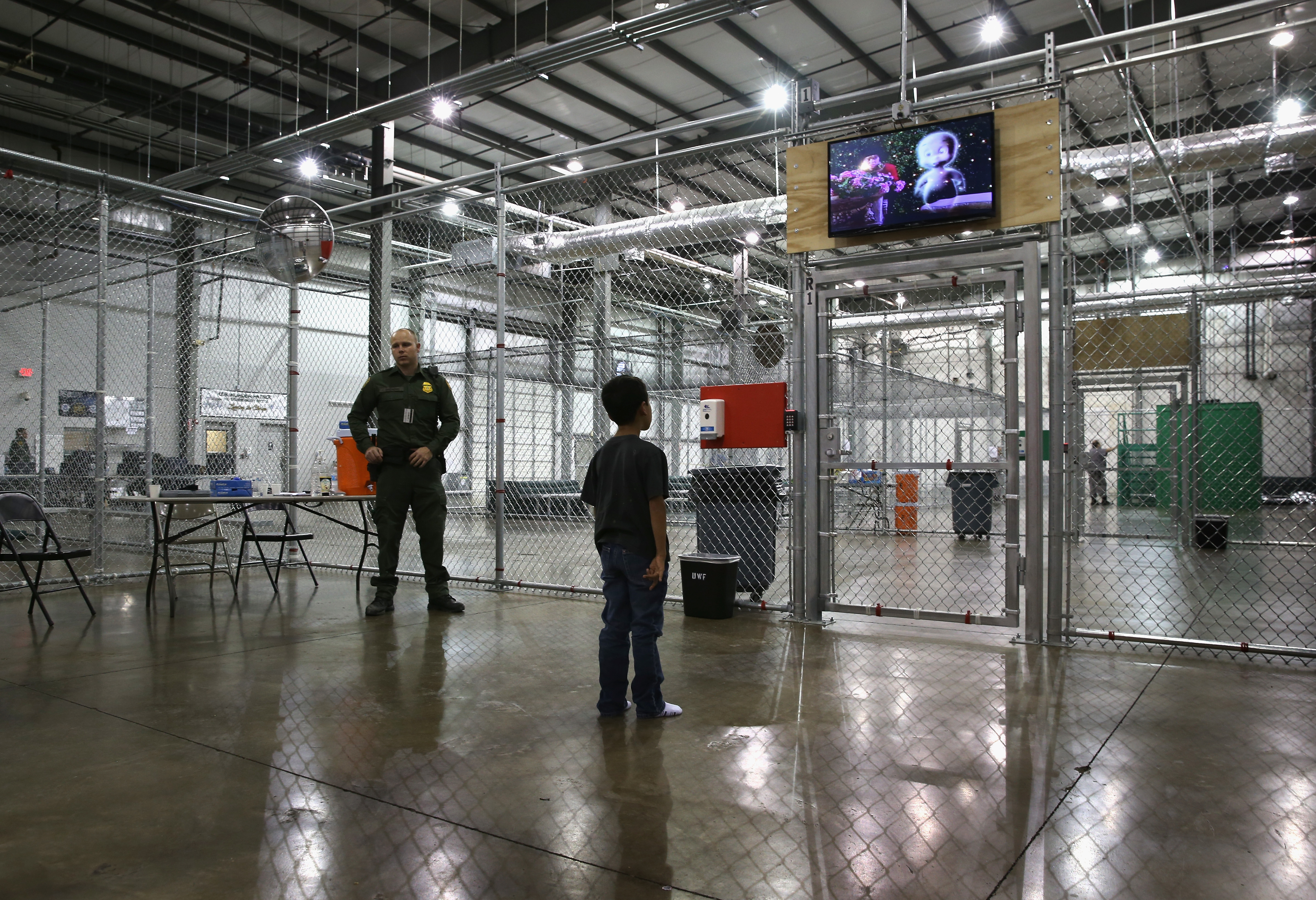 A boy from Honduras watches a movie at a detention facility run by the U.S. Border Patrol on September 8, 2014 in McAllen, Texas. The Border Patrol opened the holding center to temporarily house the children after tens of thousands of families and unaccompanied minors from Central America crossed the border illegally into the United States during the spring and summer.