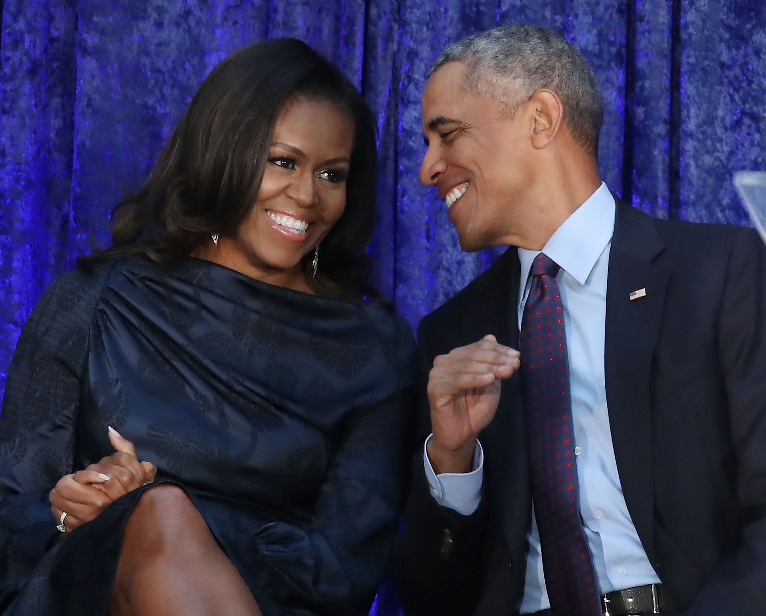 Former U.S. President Barack Obama and first lady Michelle Obama participate in the unveiling of their official portraits during a ceremony at the Smithsonian's National Portrait Gallery, on February 12, 2018 in Washington, DC. The portraits were commissioned by the Gallery, for Kehinde Wiley to create President Obama's portrait, and Amy Sherald that of Michelle Obama.