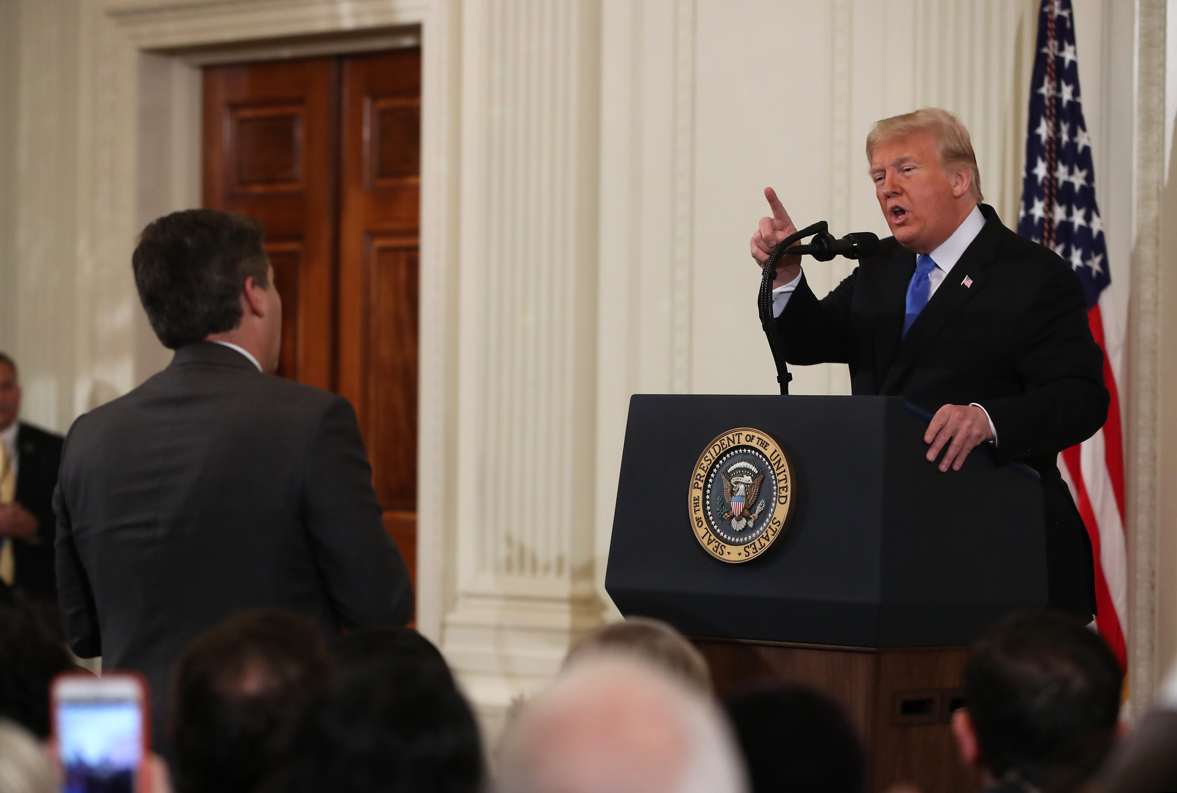 U.S. President Donald Trump answers a question from Jim Acosta of CNN after giving remarks a day after the midterm elections on November 7, 2018, in the East Room of the White House in Washington, DC. (Getty Images)