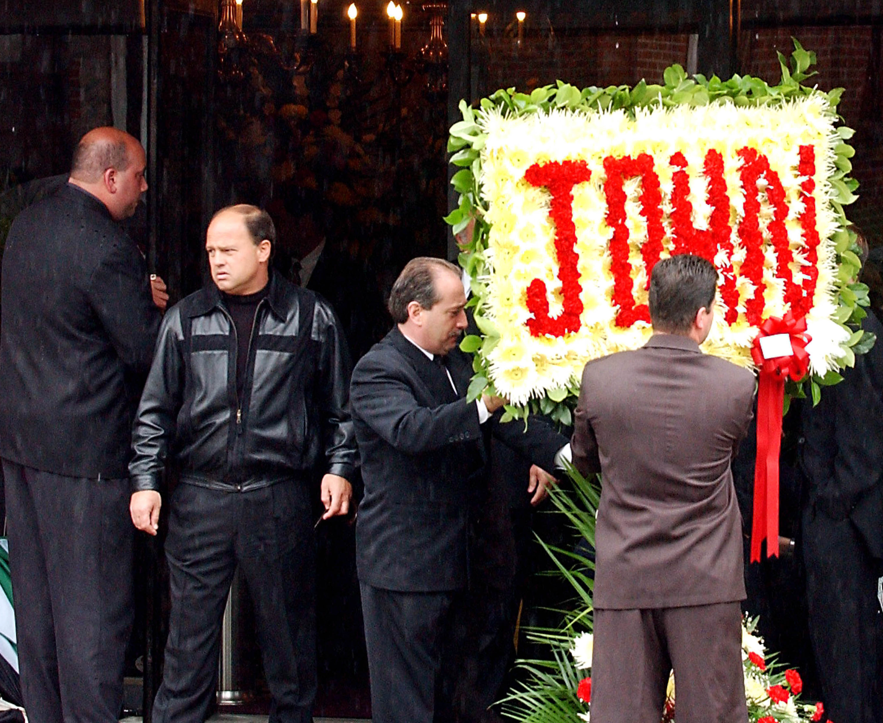 A floral arrangement with the name John spelled in flowers is placed in front of the Papavero funeral home for the wake of the late mobster John Gotti, June 14, 2002 in the Queens borough of New York City. Gotti will to be interred in a crypt the following day at St John's Cemetery in Middle Village, Queens.