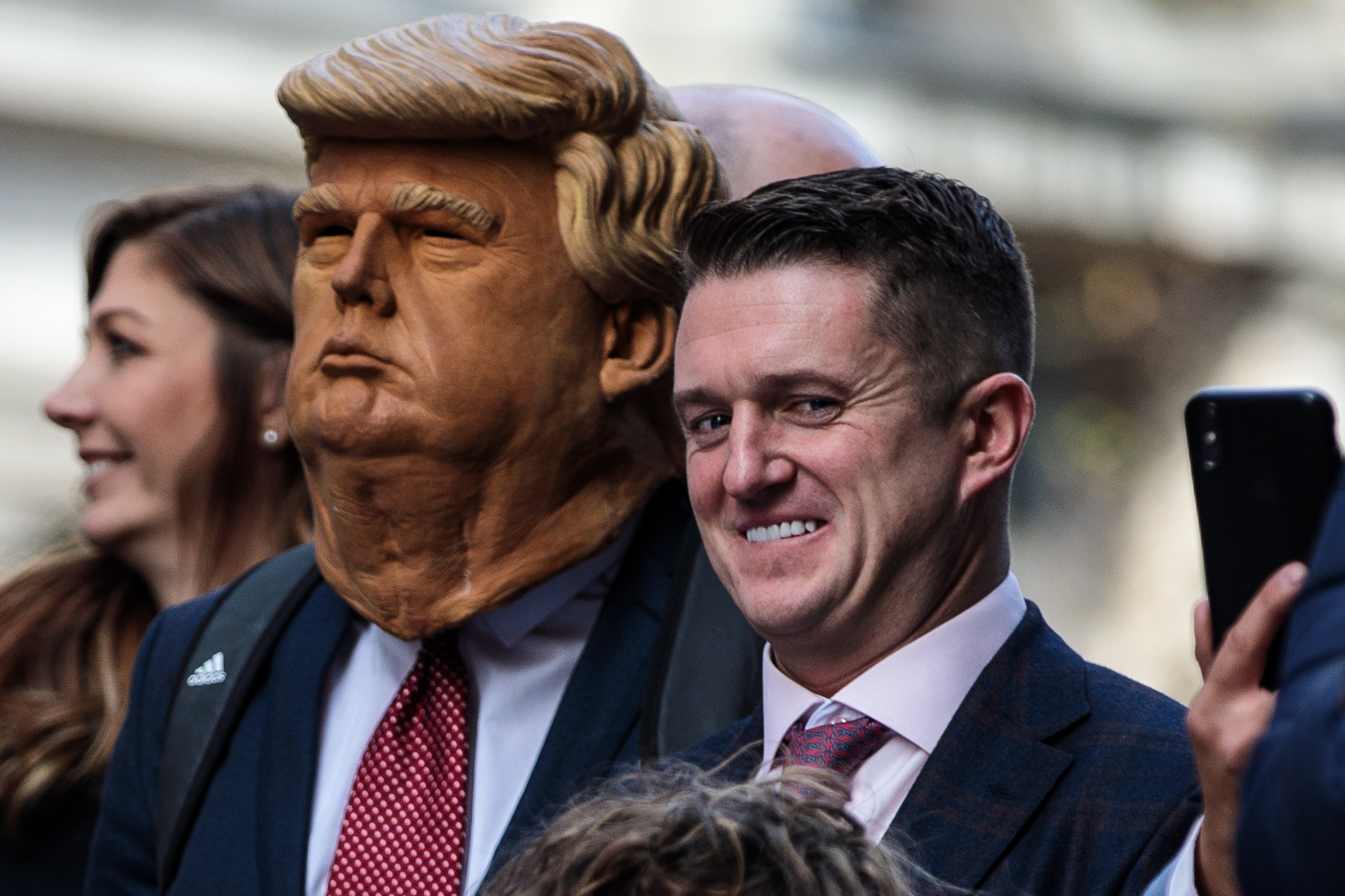 Far-right figurehead Tommy Robinson, real name Stephen Yaxley-Lennon stands beside a man in a Donald Trump mask as he addresses supporters outside the Old Bailey on October 23, 2018, in London, England. The Former English Defence League leader and British National Party member is facing a re-trial on charges of contempt. (Getty Images)
