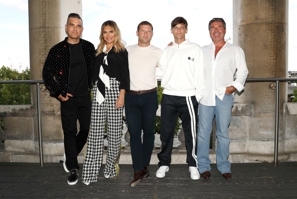 Robbie Williams, Ayda Field, host Dermot O'Leary, Louis Tomlinson and Simon Cowell pose during The X Factor 2018 launch at Somerset House on July 17, 2018 in London, England. (Photo by John Phillips/Getty Images)