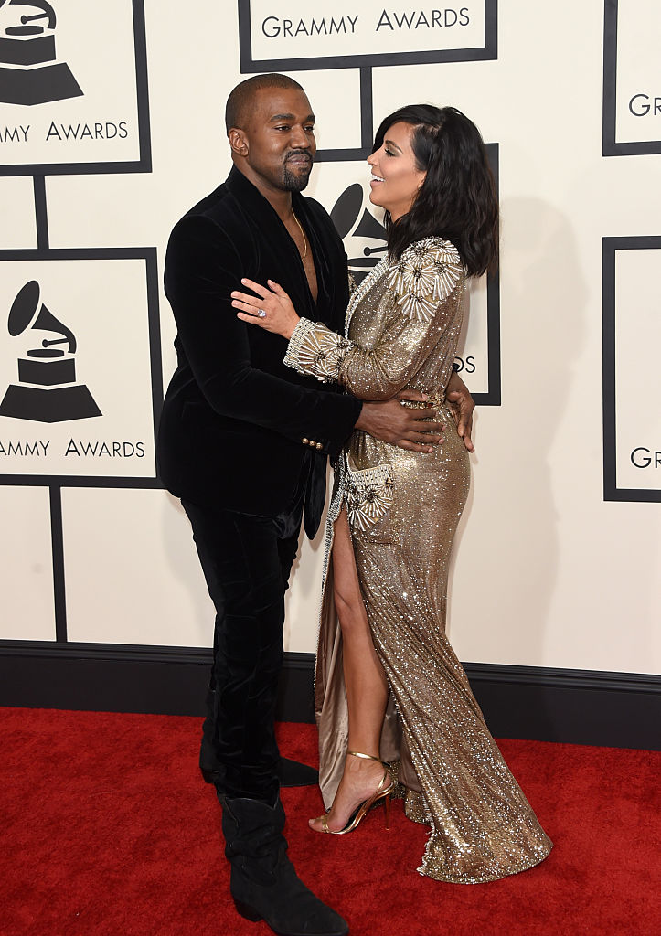 Rapper Kanye West (L) and TV personality Kim Kardashian attend The 57th Annual GRAMMY Awards at the STAPLES Center on February 8, 2015 in Los Angeles, California. (Photo by Jason Merritt/Getty Images)