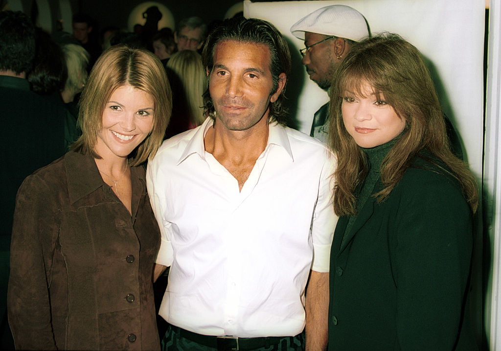 Designer Mossimo Giannulli with actress wife Lori Loughlin left, and actress Valerie Bertinelli attend a party to launch the famed sportswear designer Mossimo Giannulli Collection November 9, 2000 at The Drive-In Studios in New York City. (Photo by George DeSota/Getty Images)