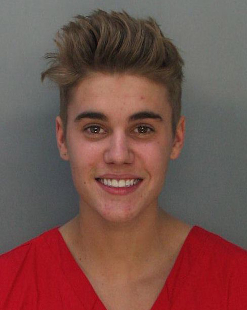 In this handout photo provided by Miami-Dade Police Department, pop star Justin Bieber poses for a booking photo at the Miami-Dade Police Department on January 23, 2014 in Miami, Florida. Justin Bieber was charged with drunken driving, resisting arrest and driving without a valid license after Miami Beach Police found the pop star street racing on Thursday morning.