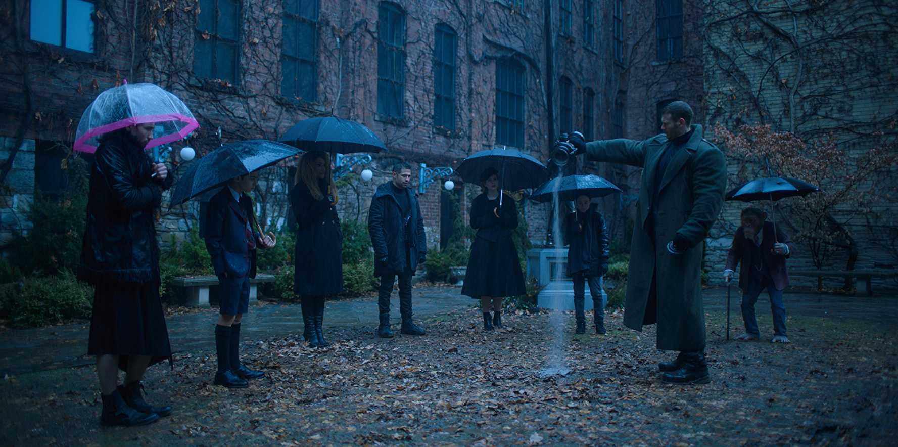 The Academy saying a last goodbye to their adoptive father in 'The Umbrella Academy'. (Source: IMDB)
