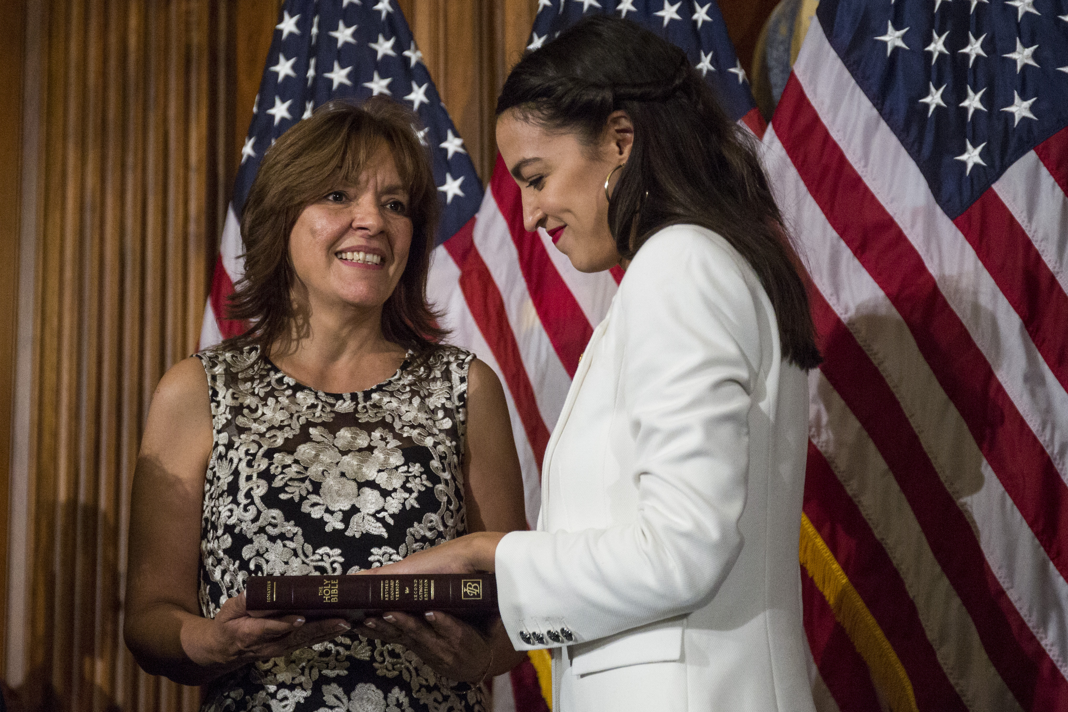 Rep. Alexandria Ocasio-Cortez (D-NY), takes part in a ceremonial mock swearing-in ceremony with House Speaker Nancy Pelosi on Capitol Hill on January 3, 2019 in Washington, DC. (Getty Images)
