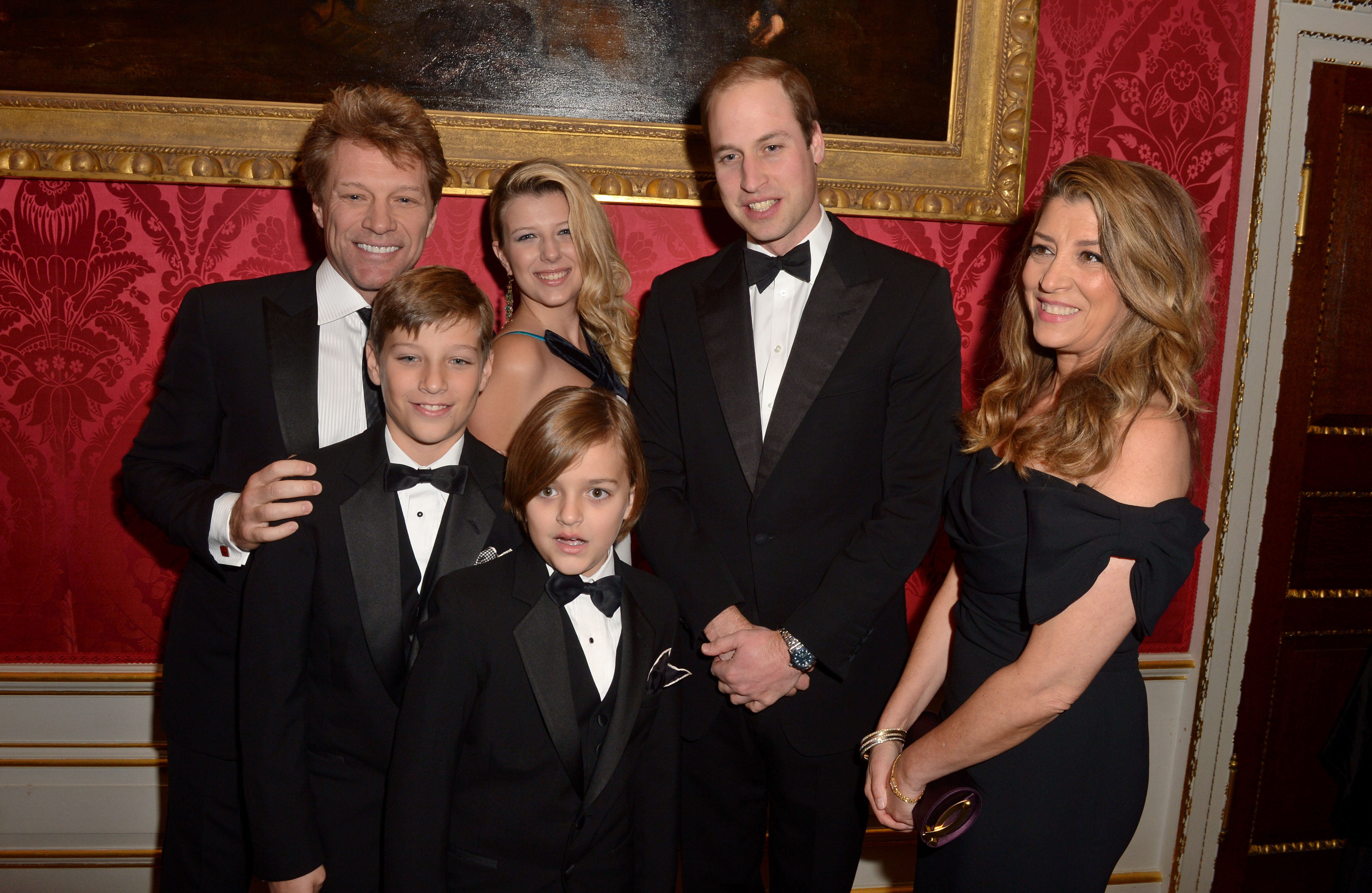 Prince William, Duke of Cambridge meets Jon Bon Jovi and wife Dorothea Hurley and their children Jacob, Stephanie and Romeo at Kensington Palace for the Centrepoint Winter Whites Gala on November 26, 2013, in London, England. (Getty Images)