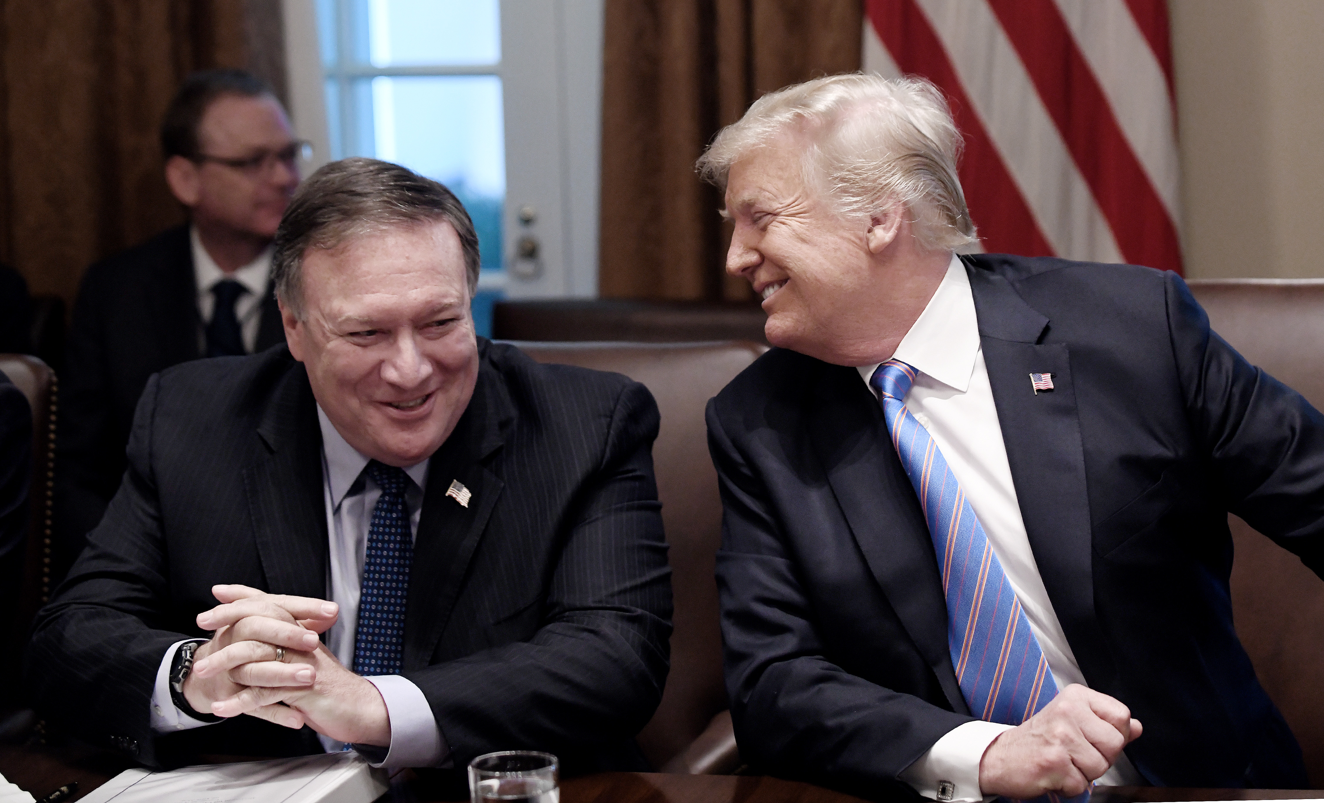 (AFP OUT) Secretary of State Mike Pompeo and President Trump share a laugh during a cabinet meeting with U.S. President Donald Trump in the Cabinet Room of the White House, July 18, 2018 in Washington, DC. (Getty Images)