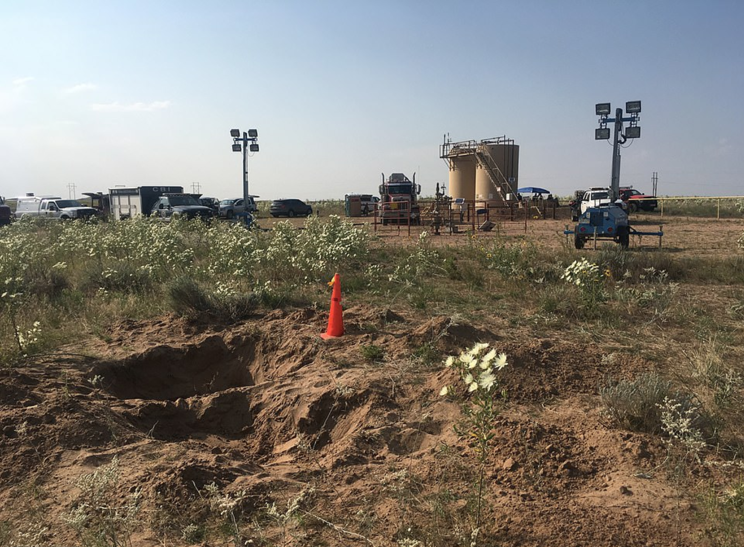 The shallow grave where he buried Shanann and the oil tanks where he immersed the bodies of Bella and Celeste (Source: Weld County District Attorney's Office)