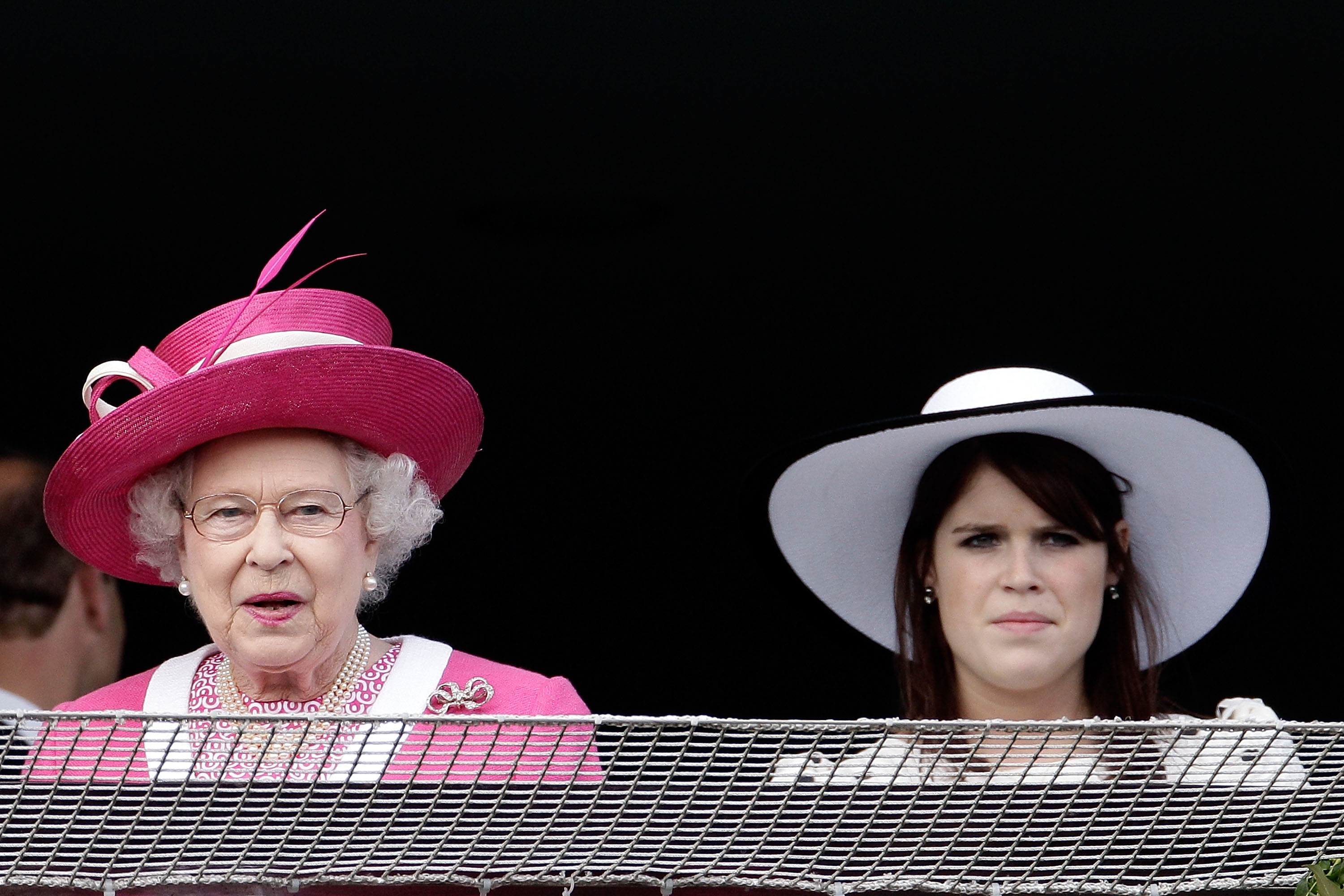 Queen Elizabeth II and Princess Eugenie react as the Queen's horse Carlton House comes in third in the Epsom Derby at Epsom Downs racecourse on June 4, 2011 in Epsom, England. Carlton Hall had been the Bookmakers favourite to win the Derby, but came in third place, with Pour Moi winning.