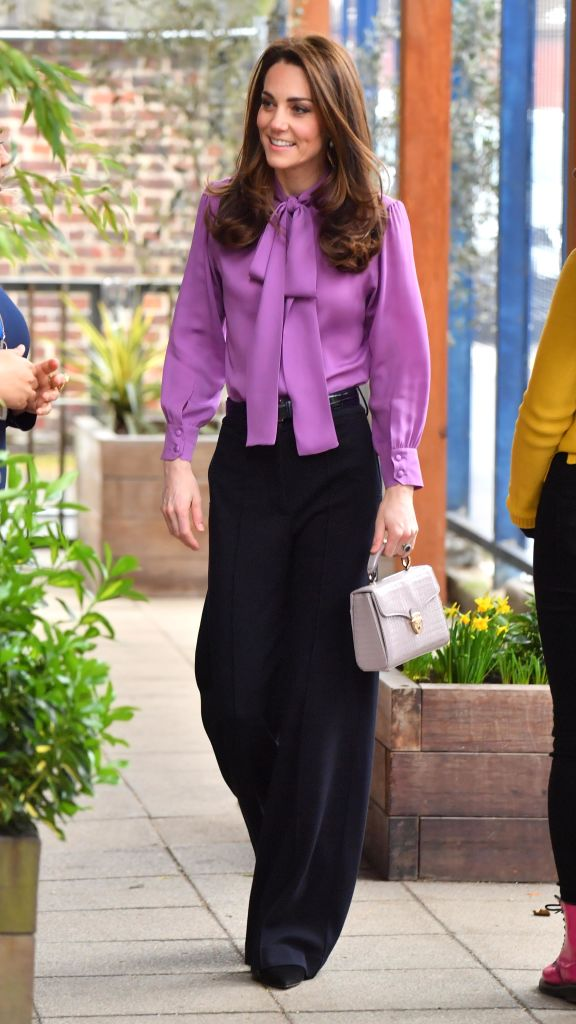 Kate Middleton was seen sporting a £790 Gucci blouse while at a children's center (Source: Getty Images)