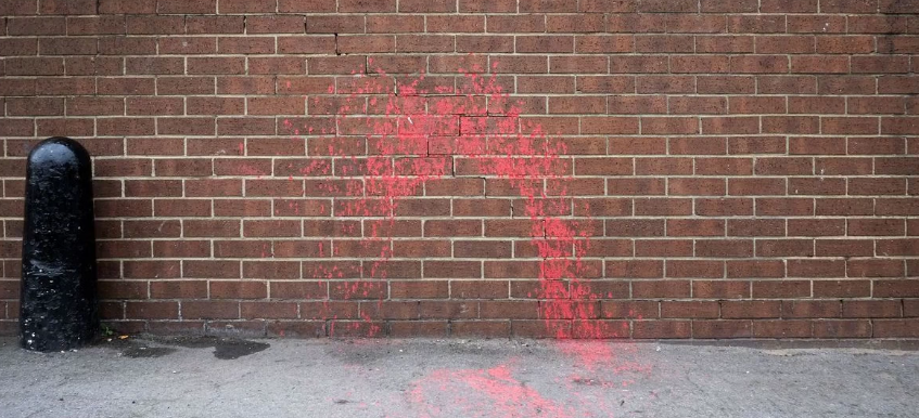 The wall where Cash sat still has the spray paint (Source: YouTube)