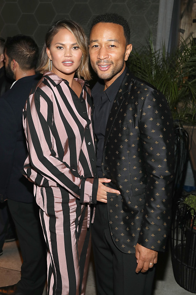 Chrissy Teigen and John Legend attend The Queer Eye Emmy Cast Party hosted by Ketel One Family-Made Vodka at Kimpton La Peer Hotel on September 8, 2018 in West Hollywood, California. (Photo by Jerritt Clark/Getty Images for Ketel One Family-made Vodka )