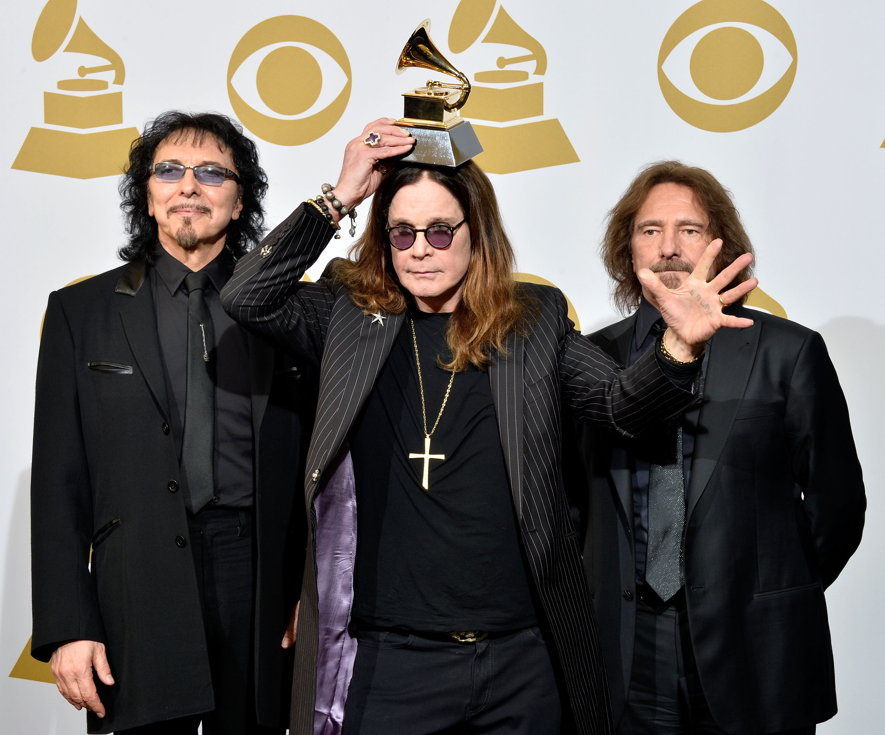 (L-R) Tony Iommi, Ozzy Osbourne and Geezer Butler of Black Sabbath pose in the press room during the 56th GRAMMY Awards at Staples Center on January 26, 2014 in Los Angeles, California. (Photo credit: Getty Images)