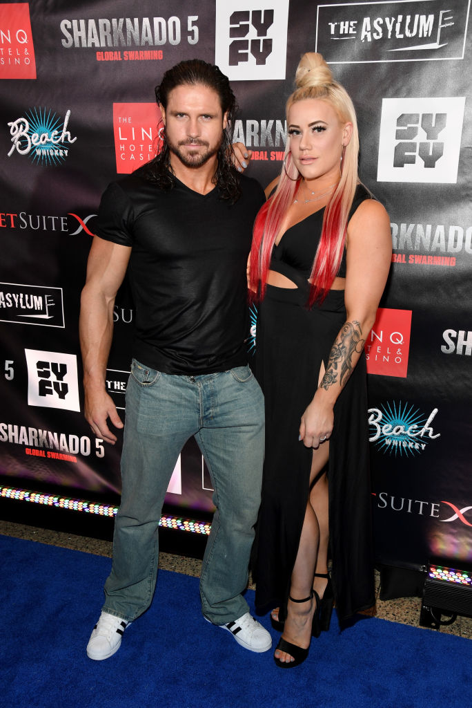 Professional wrestler and actor John Hennigan (L) and his fiancee, professional wrestler Kira Forster, attend the premiere of 'Sharknado 5: Global Swarming' at The LINQ Hotel & Casino on August 6, 2017 in Las Vegas, Nevada. (Photo by Ethan Miller/Getty Images for Caesars Entertainment)