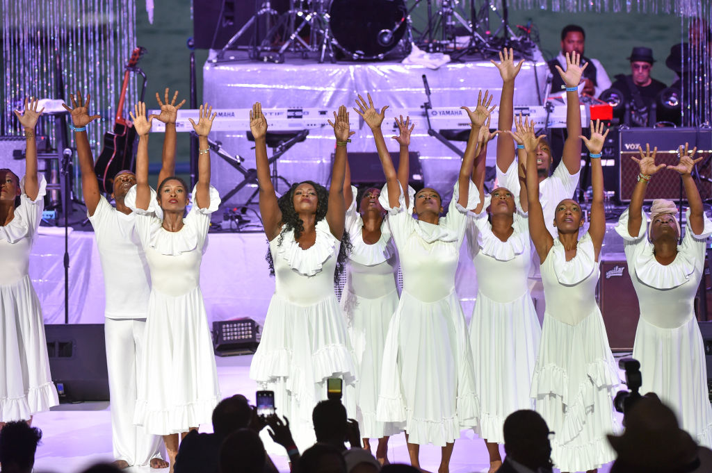 Dancer-choreographer Lisa McCall and dancers perform on stage at a Tribute Concert to celebrate the life of songstress Aretha Franklin at Chene Park on August 30, 2018 in Detroit, Michigan. (Photo by Aaron J. Thornton/Getty Images)