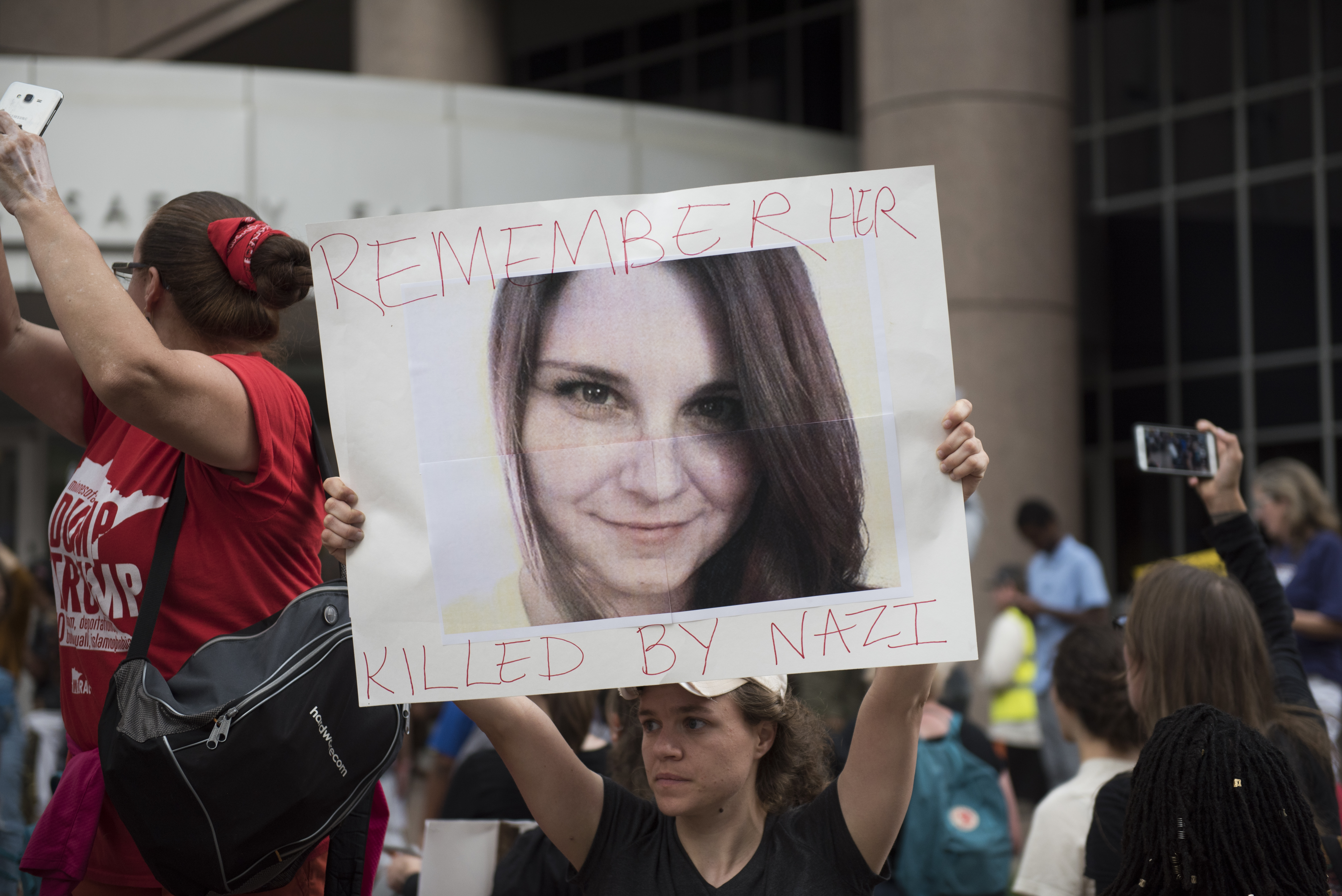 A protesters carries an image of Heather Heyer during a demonstration against racism and the violence over the weekend in Charlottesville, Virginia on August 14, 2017 in Minneapolis, Minnesota. Protesters estimated at more than 1,000 blocked streets and light rail during the action.