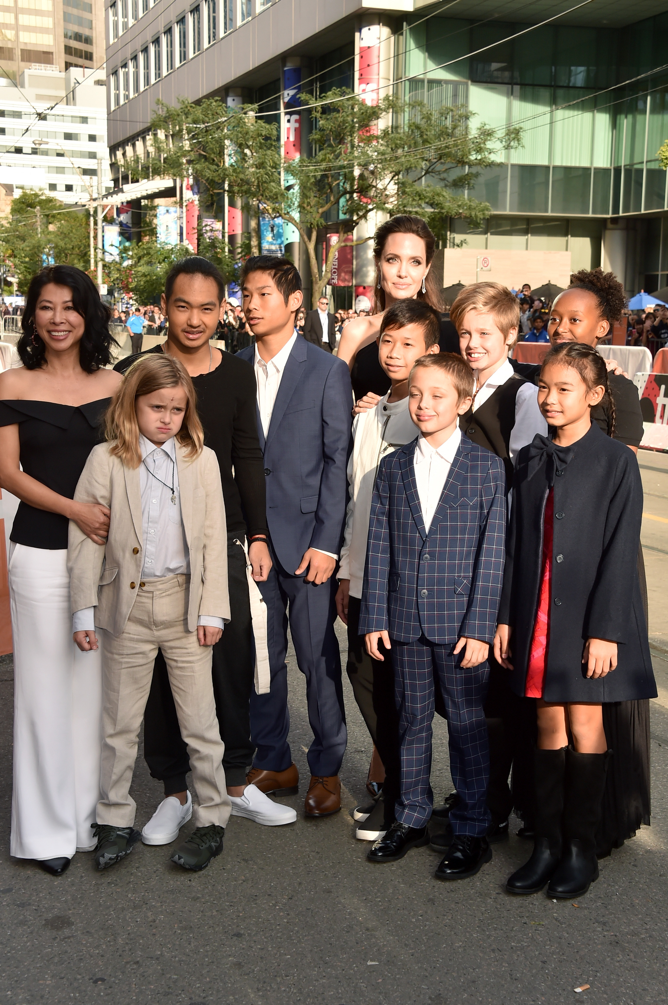 (L-R) Loung Ung, Vivienne Jolie-Pitt, Maddox Jolie-Pitt, Pax Jolie-Pitt, Angelina Jolie, Kimhak Mun, Knox Jolie-Pitt, Shiloh Jolie-Pitt, Zahara Jolie-Pitt and Sareum Srey Moch attend the 'First They Killed My Father' premiere during the 2017 Toronto International Film Festival at Princess of Wales Theatre on September 11, 2017 in Toronto, Canada.