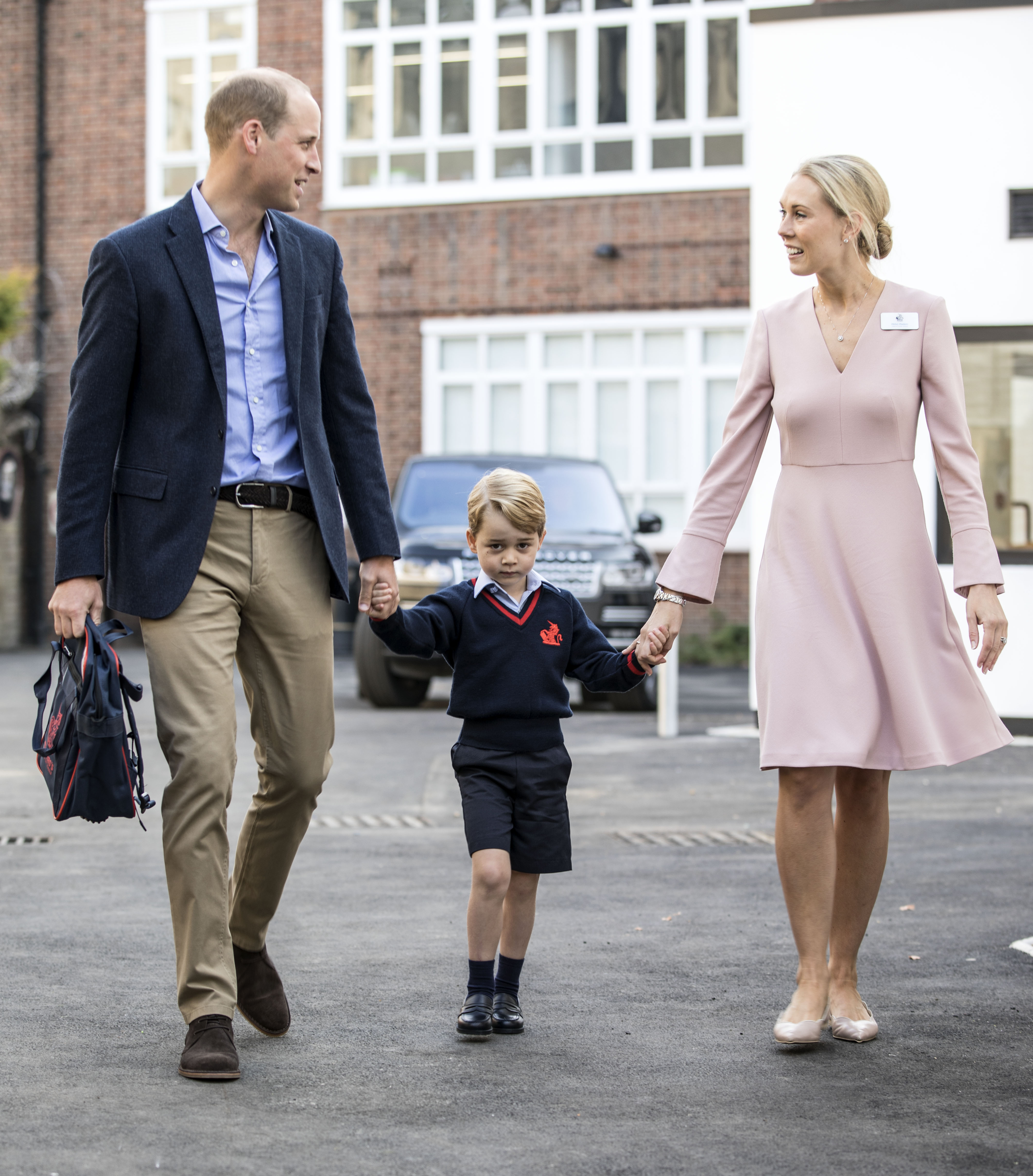 Prince George of Cambridge arrives for his first day of school with his father Prince William, Duke of Cambridge as they are met Head of the lower school Helen Haslem at Thomas's Battersea on September 7, 2017 in London, England