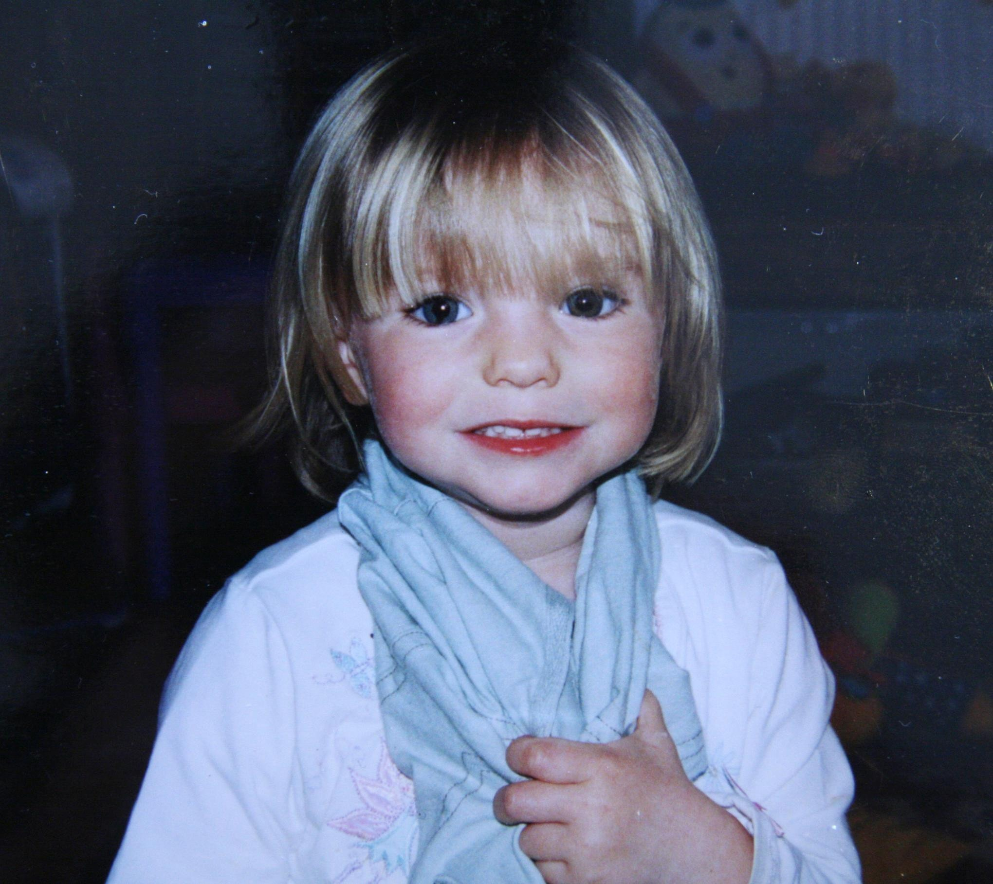 In this handout photo, relased September 16, 2007 missing child Madeleine McCann smiles. The McCann family have returned from Portugal after local police questioned them on the disappearance of daughter Madeleine, who vanished from their hoiliday apartment in Praia da Luz, Portugal, on May 3, 2007. Portugal's public prosecutor is reviewing police papers detailing the Madeleine McCann inquiry.