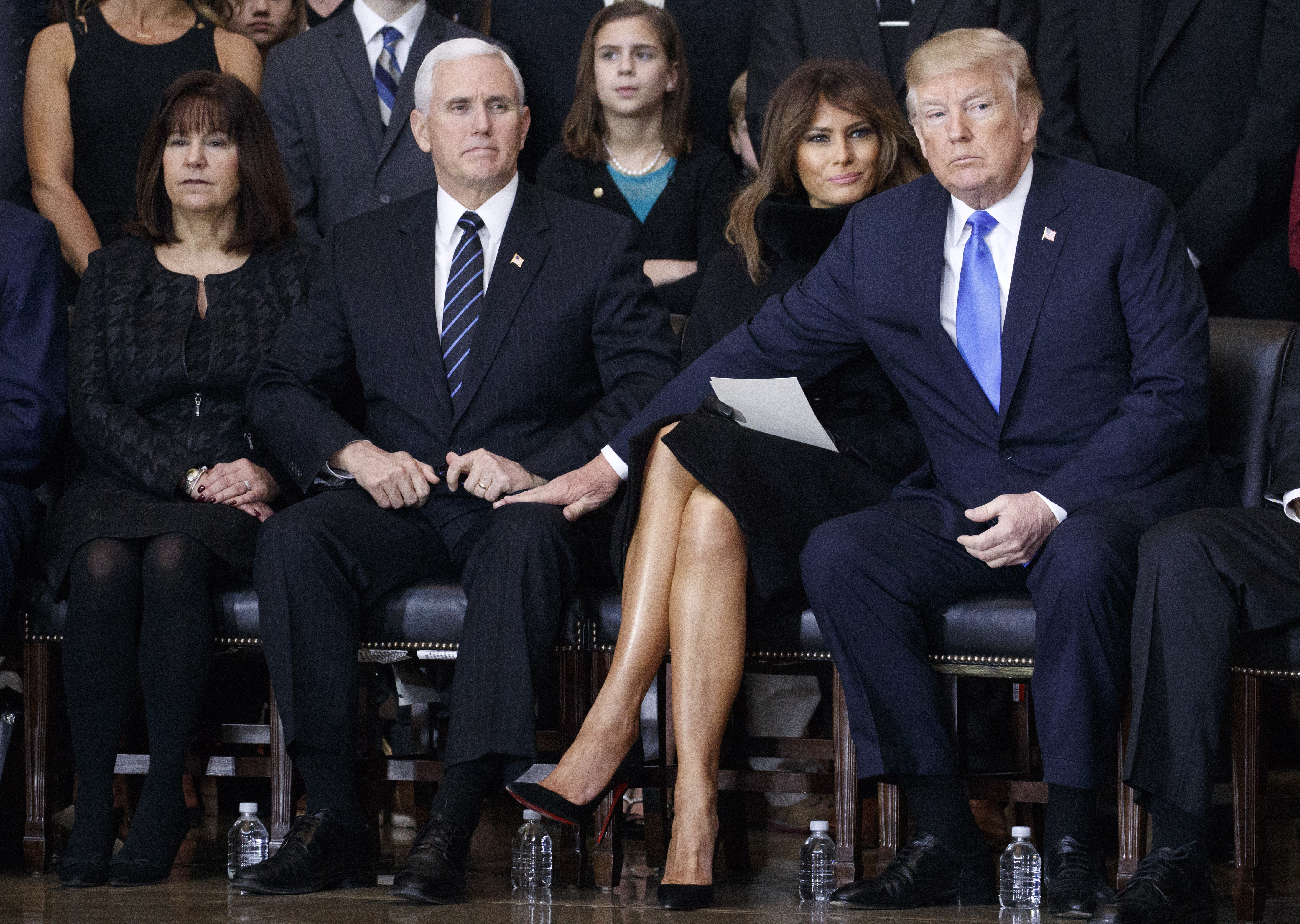 (AFP-OUT) (L-R) Second lady Karen Pence, U.S. Vice President Mike Pence, first lady Melania Trump and President Donald Trump attend the ceremonies as the late evangelist Billy Graham lies in repose at the U.S. Capitol, on February 28, 2018, in Washington, DC. Rev.