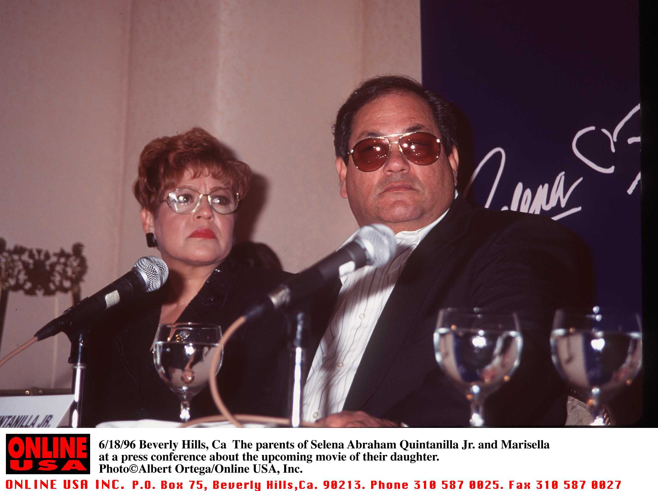 The parents of Selena Abraham, Quintanilla Jr. and Marisella, at a press confrence regarding a movie based on their daughter on June 18, 1996 (Source: Getty Images)