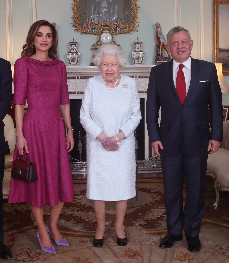Her Highness took center stage in the official pictures of the meeting, but when people tried to get a clearer view of the Queen's hands, they looked strangely bruised and purple, giving people reason to fear for her well-being. (Photo by Yui Mok - WPA Pool/Getty Images)